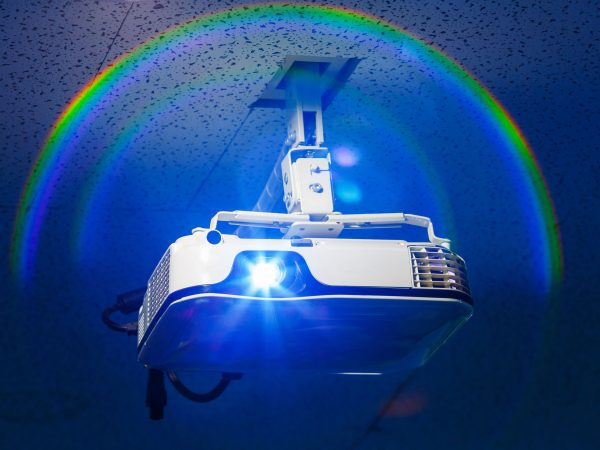 Projector hang on ceiling in meeting room with real halo effect