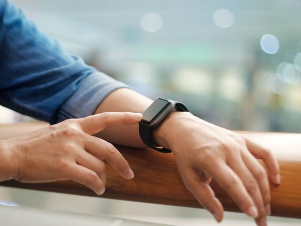 Men hands touch and setting smart watch, modern life,  business and technology concept.