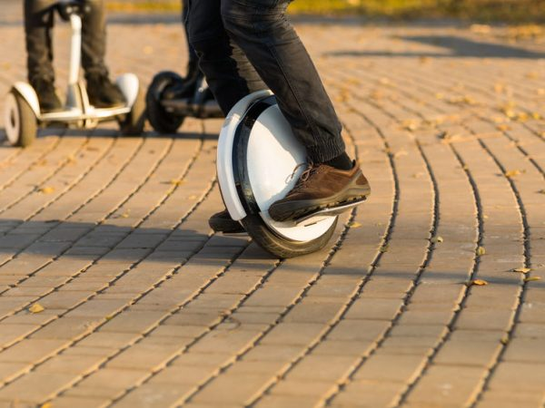 Man legs mono wheel personal electrical transport street outdoor