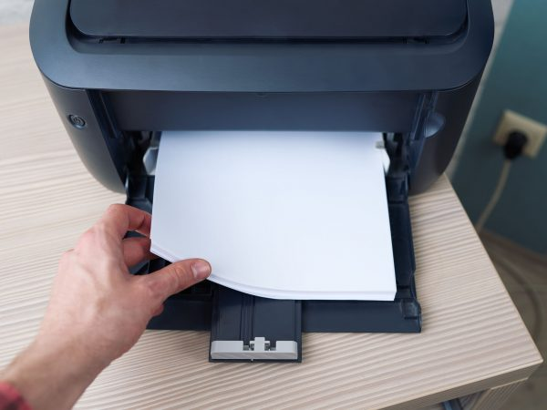 lay down or take the paper from  printer