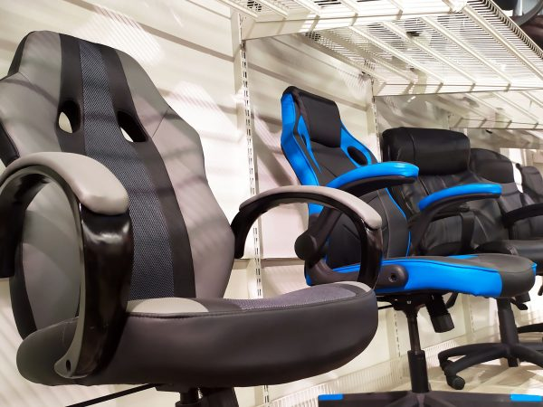 Different computer gamer soft ergonomic chairs in the furniture store.