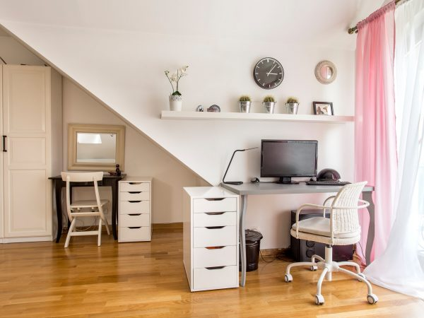 Home office room with the desk, chest of drawers, wardrobe, chairs, parquet floor and window